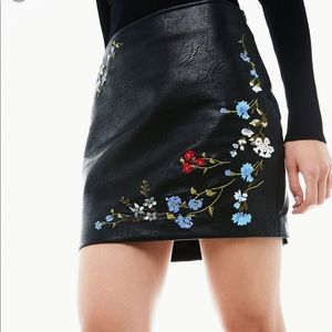 Black leather skirt with floral embroidery
